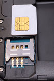 Insert sim card. In a mobile phone Stock Photography