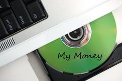 Inserte el CD mi dinero Fotografía de archivo libre de regalías
