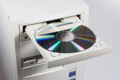 Inserte el CD o el DVD Foto de archivo