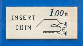 Inserte la moneda Imágenes de archivo libres de regalías