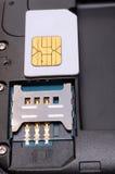 Inserte la tarjeta del sim Fotografía de archivo
