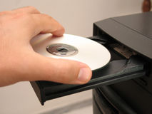 Inserting the CD. In a CD-ROM drive stock image