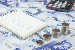 Inserting a coin into a piggy bank Stock Images