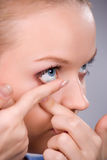 Inserting a contact lens Stock Photo