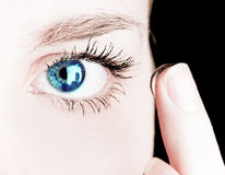 inserting a contact lens Royalty Free Stock Photo