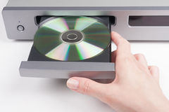 Inserting a disc into a CD player Stock Image