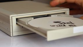 Inserting Disc into DVD ROM Device stock video
