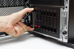 Inserting disk into data server.  Royalty Free Stock Images