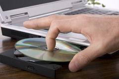 Inserting a DVD stock photos