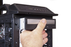 Inserting a DVD drive Stock Image