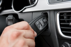 Inserting hightech car key. Hand inserting hightech car key Royalty Free Stock Image
