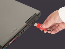 Inserting memory stick Royalty Free Stock Photo