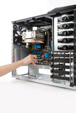 Inserting motherboard in to computer case Stock Image
