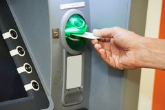 Inserting plastic card into ATM Royalty Free Stock Photos