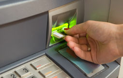 Inserting plastic card visa into ATM. Cash withdrawal. Woman's hand inserting plastic card  into the ATM Stock Photography