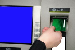 Inserting plastic card visa into ATM. Cash withdrawal. Woman's hand inserting plastic card Visa into the ATM Royalty Free Stock Photo