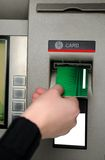 Inserting plastic card visa into ATM. Cash withdrawal. Woman's hand inserting plastic card Visa into the ATM Stock Photo