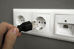 Inserting plug in outlet Royalty Free Stock Photos