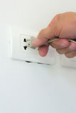 Inserting plug in outlet. Royalty Free Stock Image