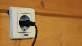 Inserting the plug into the socket stock footage