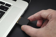 Inserting SD Card into a laptop computer Royalty Free Stock Photography