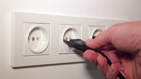 Inserting a Socket Electrical Plugs stock video footage