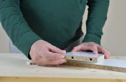 Inserting Wooden Dowels Stock Photo