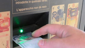 Insertion of a euro banknote stock video footage
