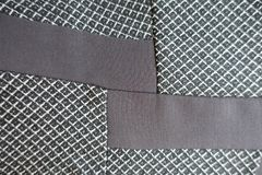 Insets of brown fabric in the grey one Royalty Free Stock Photos