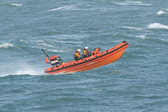 Inshore lifeboat, Weymouth, Dorset, England. R.N.L.I. Royal National Lifeboat Institution B class inshore lifeboat underway Royalty Free Stock Photos