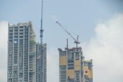 Insida förlägger för många högväxt byggnader under konstruktion och cran Royaltyfri Fotografi