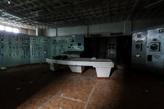Inside abandoned power plant. stock photo