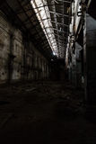 Inside abandoned power plant. Low light captures specially for creating abandonment atmosphere Royalty Free Stock Photography