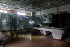Inside abandoned power plant. Low light captures specially for creating abandonment atmosphere Royalty Free Stock Photo