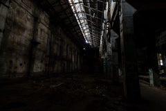 Inside abandoned power plant. Low light captures specially for creating abandonment atmosphere Royalty Free Stock Image