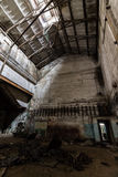 Inside abandoned power plant. Low light captures specially for creating abandonment atmosphere Royalty Free Stock Images