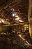 Inside an abandoned traditional French stone and wood barn stock photography