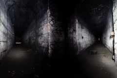 Inside the abandoned underground fuel tank. Stock Photos