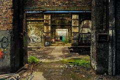 Inside abandoned and weathered factory building royalty free stock photography