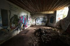 Inside an abandoned WWII concrete casemate with graffiti on the French Atlantic coast.  stock photo