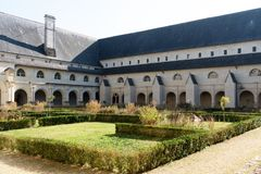 Inside the Abbey of Fontevraud, the cloister forms the center of stock image