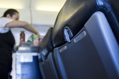 Inside airplane close-up of seat with catering Royalty Free Stock Photo