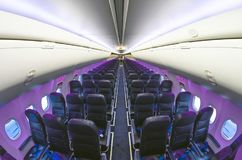 Inside airplane light view in passenger seats. Inside airplane light view in passenger seats Royalty Free Stock Image