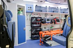 Inside an ambulance car. Inside an ambulance with medical equipment for helping patients before delivery to the hospital royalty free stock images
