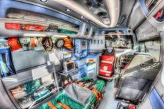 Inside the ambulance. HDR version. Inside the ambulance, view from the sanitary compartment. Different medical equipment and a stretcher. Selective focus, high royalty free stock photos