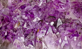 Inside of an amethyst geode. Close up on an crystal amethyst geode.Amethyst is a protective and spiritual stone that is used to open your awareness of your Royalty Free Stock Photos