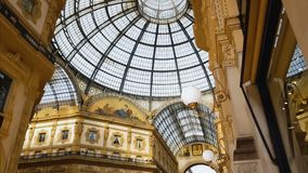 Inside arcade of famous Galleria Vittorio Emanuele II, historical architecture. Stock footage stock video footage