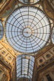 Inside the Arcade with a glass roof and steel  in Milan Italy. Inside Arcade dedicated d to Vittorio Emanuele II King of Italy with a glass roof and steel and Stock Images