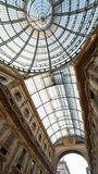 Inside the Arcade with a glass roof and steel  in Milan Italy. InsideArcade dedicated d to Vittorio Emanuele II King of Italy with a glass roof and steel and Stock Image