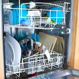 Inside of as dishwasher containing dirty dishes Stock Images
